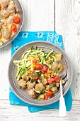 Meatballs with aubergine, tomatoes and courgette strips