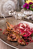 Korma lamb chops with pomegranate seeds