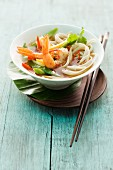 Oriental noodle soup with prawns and vegetables