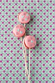 Macaroon lollies decorated with edible paper