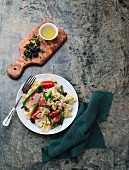 Pasta with green beans and trout fillet
