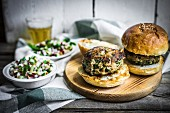 Healthy homemade burgers with vegetable salad and beer