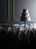 A three-tiered wedding cake on a cake stand
