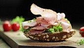 Sliced ham on seeded bread with salad