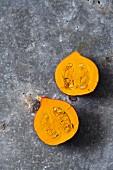 A small Hokkaido pumpkin, halved