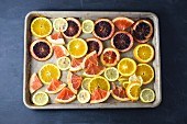 Various slices of citrus fruit on a baking tray