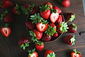 Fresh strawberries and a silver bowl and next to it