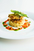 Aubergine piccata on a bed of rice with tomato sauce