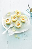 Faux mango eggs in white chocolate