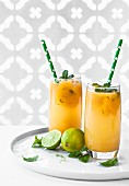 Mango and rum cocktails with limes and mint
