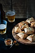 Pork and apple pies with chutney and beer
