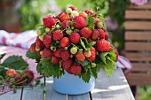 Bouquet of strawberries in pot