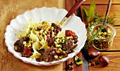 Wild boar goulash with chestnut gremolata