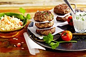 Bulgarian lamb burgers with pilau rice and a sheep's cheese sauce