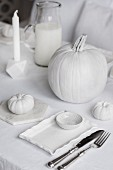 Set table with white Halloween decorations
