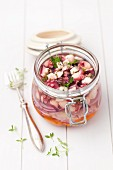 Marinated octopus with thyme and red onions in the flip-top jar