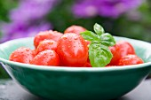 A bowl of fresh plum tomatoes
