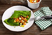Spinach pancakes with a feta and carrot medley