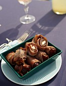Dates filled with feta cheese and wrapped in ham for a beach picnic