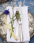 Place setting decorated with wild flowers for midsummer festival