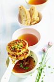 Kaspressknödel (cheesy bread dumplings with herbs) in soup