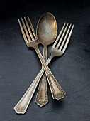 Old silver forks and a spoon