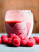 An ice cold raspberry smoothie in a glass