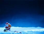 Weihnachtsmann vor blauem Nachthimmel