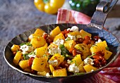 Fried potatoes with chilli beans and feta cheese