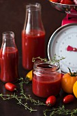 Sieved tomatoes in a jar and bottles
