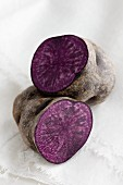 A purple potato, halved