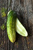 A halved gherkin on a wooden surface