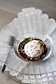 Creamy ice cream with chocolate sauce and hazelnuts