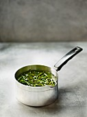 Samphire in oil in a saucepan