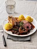 Roast beef with a red wine and olive sauce, Duchess potatoes and chicory