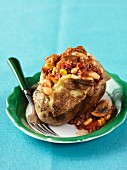 A baked potato filled with chilli