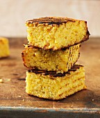 A stack of three slices of grilled cornbread
