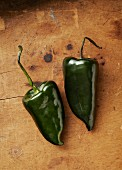 Two fresh poblano chilli peppers (seen from above)