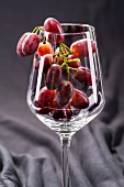 Red grapes in a wine glass