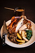 Roast chicken with stuffing, spinach, gravy and baked apples