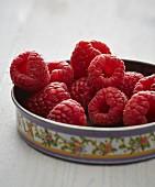 Fresh raspberries in a dish (close-up)