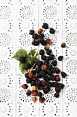 Blackberries on a lace surface