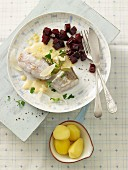 Poached cod with a butter and mustard sauce, beetroot and salted potatoes