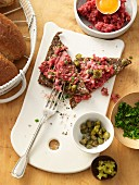 Beef tatar with capers on black bread