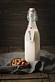Hazelnut milk in a glass bottle