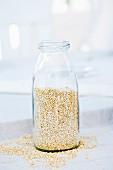 Quinoa in a glass bottle