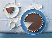 Creamy chocolate tart, sliced