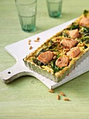 Salmon bake with spinach and pine nuts