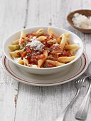 Penne all'arrabbiata (pasta with spicy tomato sauce and bacon, Italy)