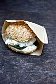 A breakfast burger with eggs Benedict and poached spinach